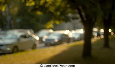 Traffic jam out of focus. - Traffic jam out of focus, sun...