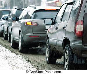 traffic jam - winter time,focus point on the automotive head...