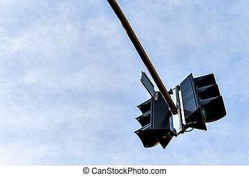 Traffic light against a clear blue sky