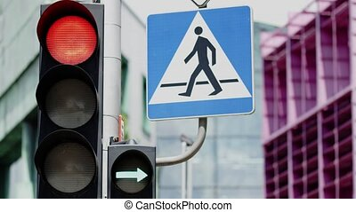 Traffic light and pedestrian crossing sign. Close-up shot on...