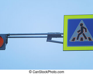 Traffic light and sign of pedestrian crossing