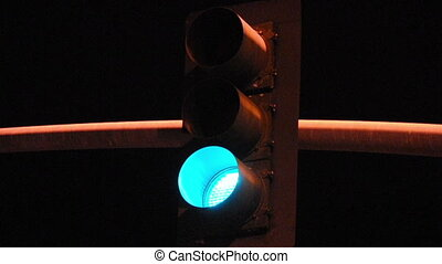 Traffic Light at Night - Traffic Light cycling through red...