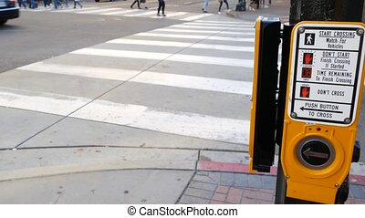 Traffic light button on pedestrian crosswalk, people have to...