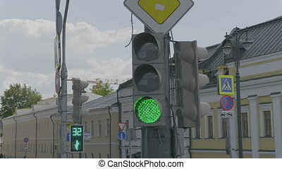 Traffic light changes from red to green. HD stock footage.