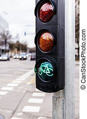 Traffic light for cyclists. Green light for bycicle lane on a traffic light.