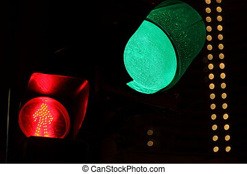 traffic light. green light bulb in focus. red light bulb in out of focus.