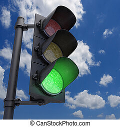 Traffic Light Green - Traffic Light in a blue sky with only...