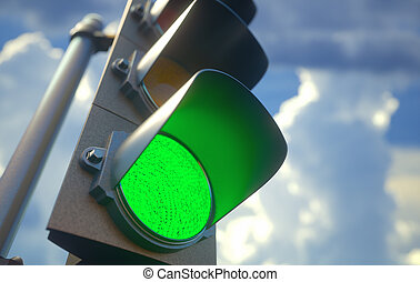 Traffic light with green light on, signal open to go ahead.