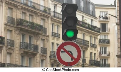 Traffic light in the street. Sign of left turn prohibited....