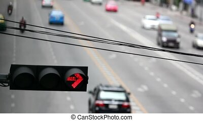 Traffic light on a city street and moving car.