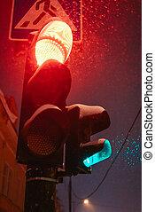 Traffic light on a snowy night