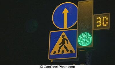 Traffic light regulates cars and pedestrians