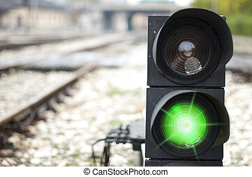 Traffic light shows red signal on railway. Green light
