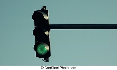 Traffic light signalization or semaphore turning from green...