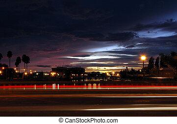 Light Streaks of Moving Traffic Against Late Sunset, Weber Point, Stockton, California, USA
