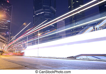 traffic light trails at modern city street,hongkong.