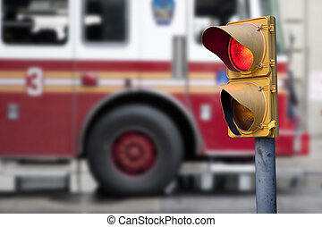 Traffic light with fire engine in background