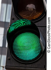 a traffic light is green light for unlimited travel through the intersection