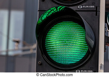 a traffic light shows green light for unlimited travel through the intersection