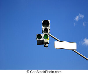 Traffic light with green sign turned on