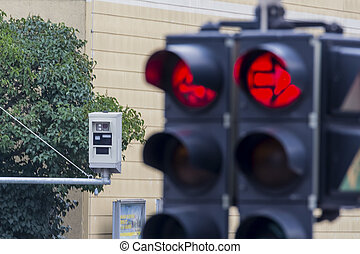 traffic light with red light camera - the red light of a...