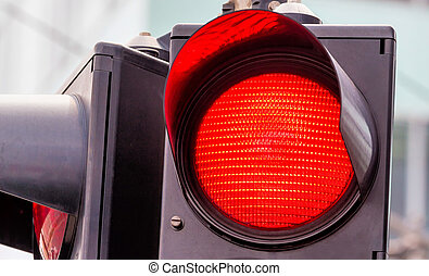 traffic light with red light - a traffic light shows red...