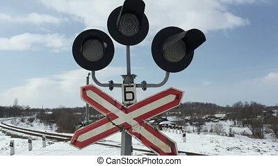 Traffic lights at a railway crossing.