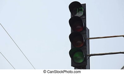Traffic lights at the crossroads - Working traffic light at...