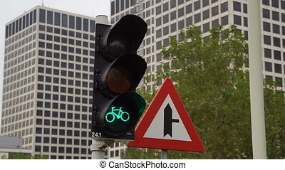 Traffic lights for Bicycles at the intersection. Red traffic lights for bikes