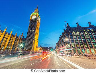 Traffic lights in the night under Big Ben - London