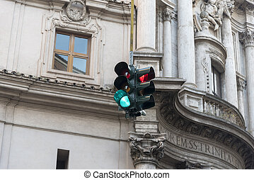 Traffic lights on the background of the city house.