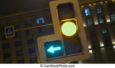 Traffic lights regulate the movement of vehicles. At night in the winter.