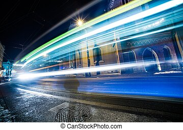 Traffic Lights in Long Time Exposure. Speeding Tramway and...