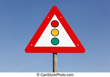 Traffic lights warning triangle road sign