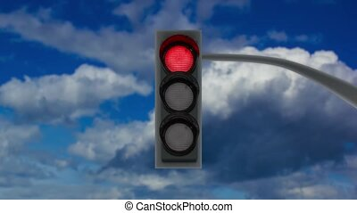 Traffic lights with changing color lamps on pole against sky