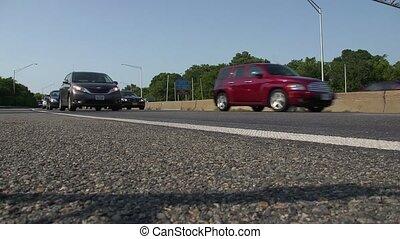 A low angle shot of slow freeway traffic
