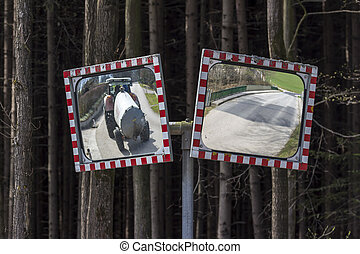 traffic mirror - two traffic lights stand at the...