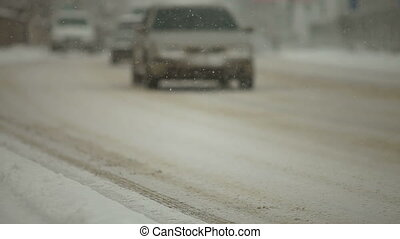 Traffic moving slow through a snow