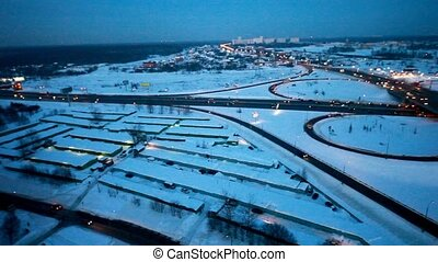 traffic of cars around a crossroads on winter highway -...