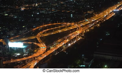traffic of cars in a big city at night
