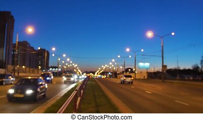 Traffic of the evening city. Evening city at high mode. Highway at rush hour. Blurring background of night city.