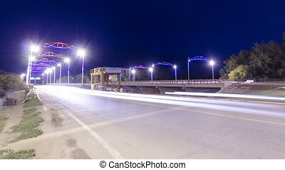 Traffic on a bridge in Uralsk night timelapse hyperlapse....