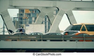 Traffic on a city car bridge. Telephoto lens pan shot -...