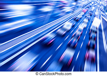 traffic on a freeway with blurred cars in evening