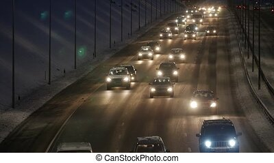 Traffic on a highway at night.