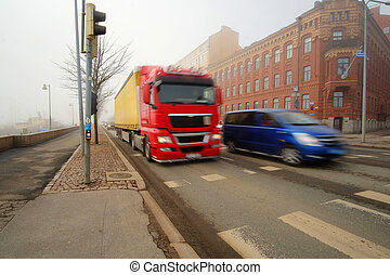 Traffic on a street - Helsinki, Finland - April, 4, 2016:...