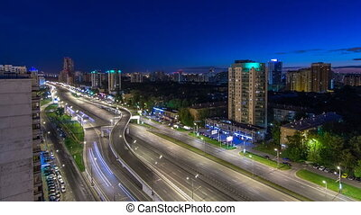 Traffic on avenue Marshal Zhukov timelapse in Moscow at night