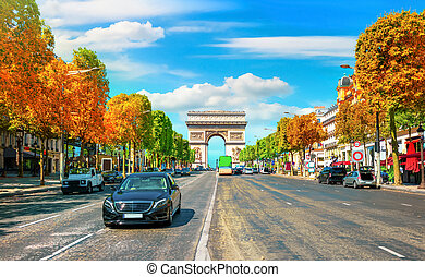 Traffic on Champs Elysee in sunny autumn day