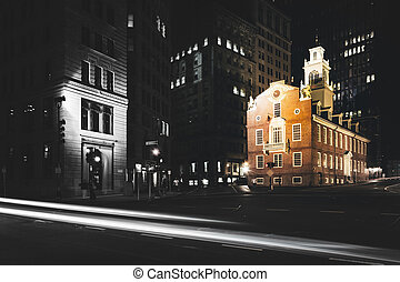 Traffic on Congress Street and the Old State House at night in B