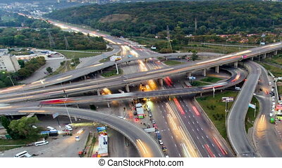 Traffic on freeway interchange. Aerial night view timelapse city traffic.